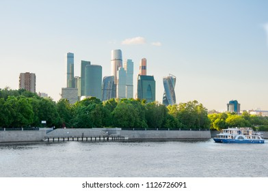 The Moscow International Business Centre from modern Luzhnetskaya embankment with boat on the Moscow River, Russia.