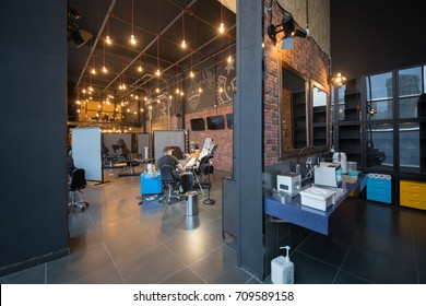 MOSCOW - JAN 23, 2017: Two men in tattoo parlor in Illskill, New Illskill complex includes car service, hookah, restaurant, barbershop and tattoo parlor