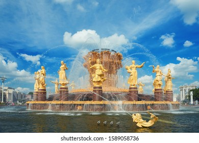 MOSCOW, JUL. 28, 2019: View on famous historical VDNKh golgen fountain Frienship of Nations. USSR Empire style fountain with sixteen woman golden sculptures dedicated to 16 Soviet Union republics