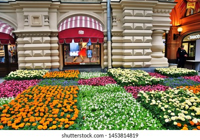MOSCOW - JULY 05, 2019: View of GUM on the Red Square in Moscow, luxury shopping mall, and Nikolskaya street decorated by flowers. Popular landmarks.
