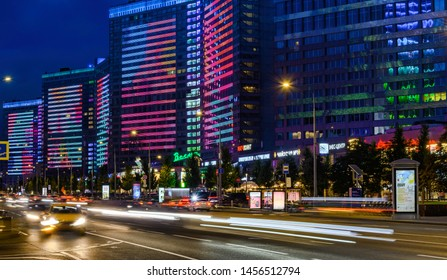Moscow - July 20, 2019: Buildings with multi-colored illumination on New Arbat street in Moscow at night.