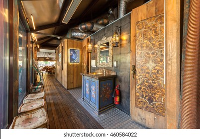 "MOSCOW - JULY 2014: The interior of the restaurant on the water ""SHATER"" in the Oriental style. Corridor with a sink and entrance to the WC"