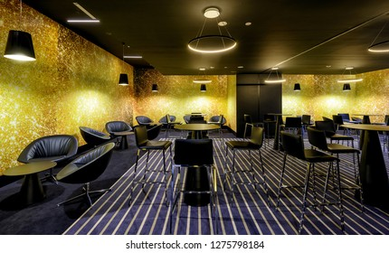 Moscow - July 21, 2014: Interior of cafe in the cinema. Panorama of the modern interior with black and yellow design.