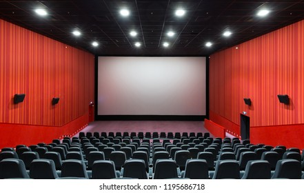 Moscow - July 21, 2014: Panoramic view of an empty cinema hall with a screen. Contemporary cinema auditorium design. Panorama of the modern movie theater interior with a stage.
