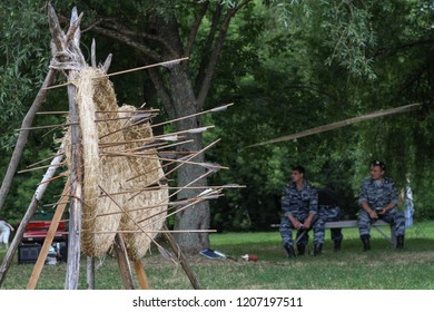 Moscow - July 7, 2012: Arrow traveling through air at high speed to archery target at the Historical festival Times and Epochs. Public-event.