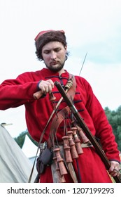 Moscow - July 7, 2012: Musketeer are preparing to fire muskets at the Historical festival Times and Epochs. Public-event.
