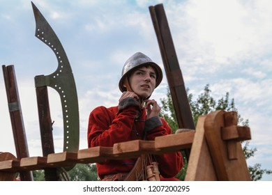 Moscow - July 7, 2012: Musketeer straightens the helmet at the Historical festival Times and Epochs. Public-event.