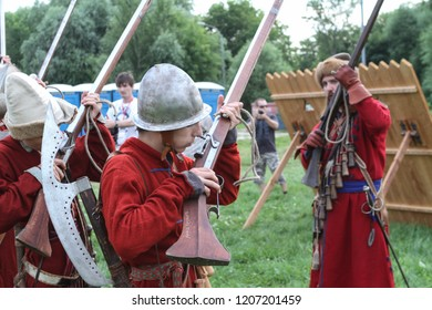 Moscow - July 7, 2012: Musketeers are preparing to fire muskets at the Historical festival Times and Epochs. Public-event.