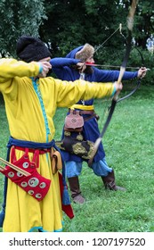 Moscow - July 7, 2012: A team of archers practicing shooting at the Historical festival Times and Epochs. Public-event.
