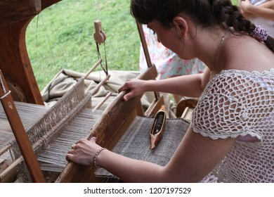 Moscow - July 7, 2012: Women make cloth on the loom at the Historical festival Times and Epochs. Public-event.