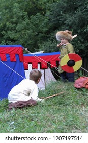 Moscow - July 7, 2012: Young boys playing with wooden swords and shields at the Historical festival Times and Epochs. Public-event.