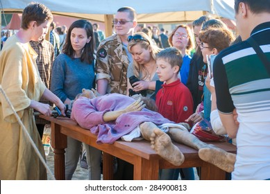 MOSCOW - JUNE 06, 2015: Historical reenactment of mummification in Ancient Rome. Times and Ages International Historical Festival in Kolomenskoye, Moscow.