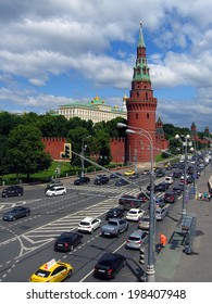 MOSCOW - JUNE 11, 2014: Many cars drive by the Moscow Kremlin walls. Moscow Kremlin is a popular touristic landmark and UNESCO World Heritage Site.