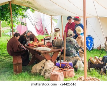 MOSCOW - JUNE 12, 2016: Persons in historical costumes. Historical festival Times and Ages in Kolomenskoye park, Moscow.