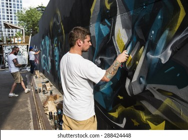 "MOSCOW - JUNE 14, 2015: Art-pad ""Flacon"". Street artist painting graffiti."