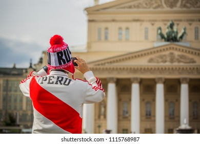 MOSCOW, JUNE 14, 2018. A fan from Peru takes pictures of the Bolshoi Theater. The period of the International FIFA World Cup 2018 in Moscow