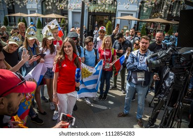 MOSCOW JUNE 14, 2018. A young female reporter of Russian television is preparing for the LIVE, surrounded by fans before the opening of the FIFA World Cup 2018 in Moscow