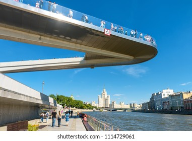 Moscow - June 16, 2018: Floating bridge in Zaryadye Park near Moscow Kremlin, Russia. Zaryadye is one of the main tourist attractions of Moscow. Beautiful view of hovering bridge above Moskva River.