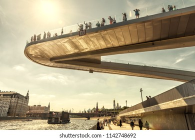 Moscow - June 16, 2018: Floating bridge in Zaryadye Park near Moscow Kremlin, Russia. Zaryadye is one of the main tourist attractions of Moscow. Amazing view of the hovering bridge above Moskva River.