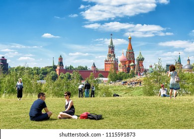 Moscow - June 17, 2018: People relax in Zaryadye Park near Moscow Kremlin, Russia. Zaryadye is one of the main tourist attractions of Moscow. Scenic view of St Basil Cathedral in Moscow centre.