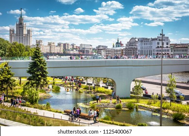 Moscow - June 17, 2018: People visit the Zaryadye Park with Floating bridge in Moscow, Russia. Zaryadye is one of the main tourist attractions of Moscow. Scenic view of the Moscow center in summer.