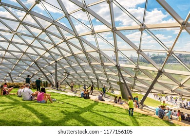 Moscow - June 17, 2018: People relax in modern amphitheater with glass roof in Zaryadye Park in Moscow center in summer, Russia. Zaryadye is one of the main tourist attractions of Moscow.