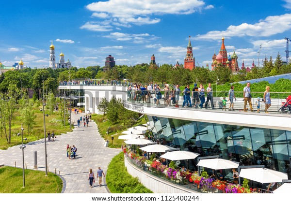 Moscow - June 17, 2018: People stroll in Zaryadye Park near Moscow Kremlin during FIFA World Cup in summer, Russia. Landscaped Zaryadye Park is the one of the main tourist attractions of Moscow.