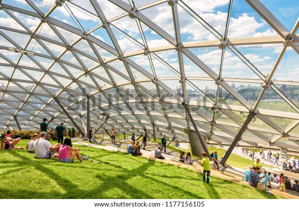 Moscow - June 17, 2018: People relax in the nice modern amphitheater with glass roof in Zaryadye Park in Moscow center in summer, Russia. Zaryadye is one of the main tourist attractions of Moscow.