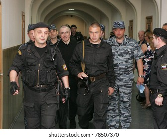 MOSCOW - JUNE 2: Mikhail Khodorkovsky, former owner of the oil giant Yukos, is escorted to court to testify at his Spanish business partner Valdes-Garcia's trial June 2, 2011 in Moscow, Russia.