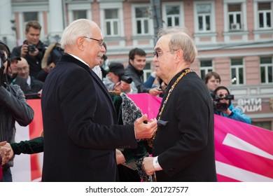 MOSCOW - JUNE, 28: Nikita Mikhalkov greeting Gleb Panfilov. 36st Moscow International Film Festival. Closing Ceremony at Rossiya Cinema . June 28, 2014 in Moscow, Russia