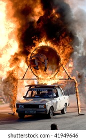 MOSCOW  - JUNE 6 : Stunt man Igor Zverev jumps through a tube of fire during a stunt man show June 6, 2008 in Moscow.
