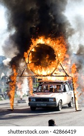 MOSCOW - JUNE 6 : Stunt man Igor Zverev jumps through a ring of fire during a stunt man show June 6, 2008 in Moscow