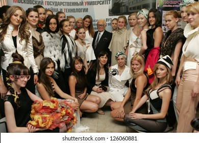 MOSCOW - JUNE 7: French designer Pierre Cardin (center) poses to photographers with students and models of the Moscow State University of Design and Technology June 7, 2011 in Moscow, Russia.