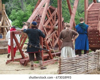 "Moscow – June 9, 2017: model of a Middle Age trebuchet ""Elephant"" about to shoot (historical reconstruction) near the ruins of Simonov (St. Simon) Monastery at ""Times and Epochs"" Festival"