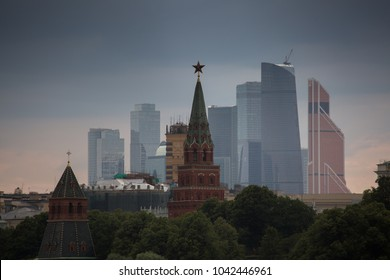 The Moscow Kremlin in front of modern Moscow city view. Evening Moscow