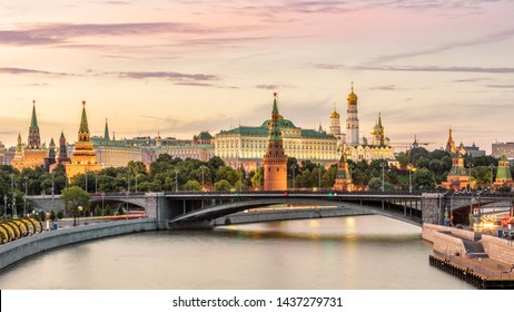 Moscow Kremlin at Moskva River, Russia. Panorama of old Moscow in summer evening. Scenic warm view of the ancient Moscow Kremlin at sunset. Beautiful cityscape of the famous Moscow center.