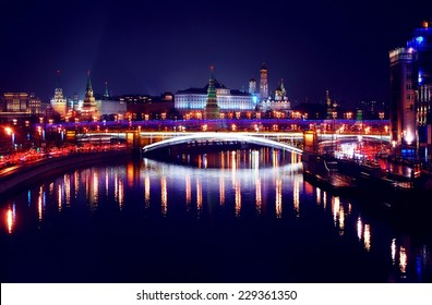 Moscow Kremlin. Night scene. The Moscow river embankment. The bridge over the river is decorated by lights in colors of Russian state flag - red, blue and white.  UNESCO World Heritage Site.