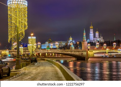 Moscow Kremlin, Moscow river and Bolshoy Moskvoretsky Bridge in Moscow, Russia. Moscow with Christmas decoration at night