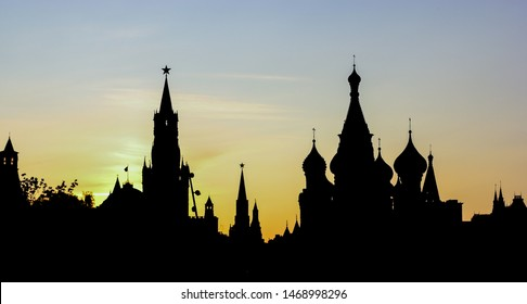 Moscow Kremlin skyline silhouette at sunset with the sun behind the buildings