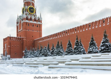 Moscow Kremlin with Spasskaya Tower on Red Square in winter, Moscow, Russia. The Red Square is the main tourist attraction of Moscow. Red Square during snowfall. Historical architecture in Moscow.