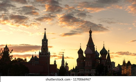 Moscow Kremlin and St Basil's Cathedral at sunset, Russia. It are the main tourist attractions of Moscow. Panoramic view of the Moscow city in summer evening. Silhouettes of Moscow landmarks at dusk.