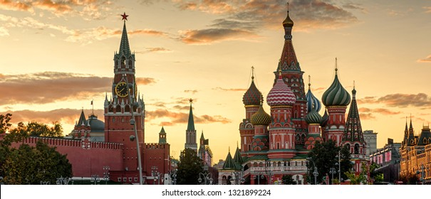 Moscow Kremlin and St Basil's Cathedral at sunset, Russia. This place is a top tourist attraction of Moscow. Panorama of the Moscow city center in summer evening. Famous Moscow landmarks at dusk.