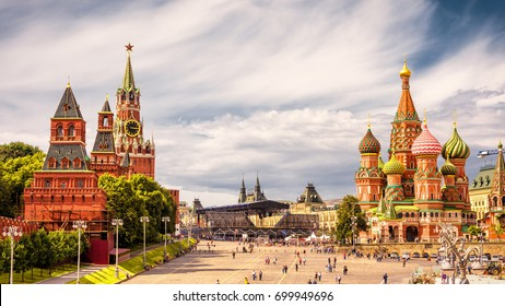Moscow Kremlin and of St Basil's Cathedral on Red Square, Moscow, Russia. Ancient Moscow Kremlin is the main tourist attraction of city. Beautiful panoramic view of the heart of Moscow on sunny day.