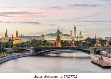 Moscow Kremlin at sunset, Russia. Panorama of Moskva River with ancient Kremlin, main landmark of Moscow. Scenic view of the famous Moscow city center. Beautiful landscape of Moscow in summer evening.