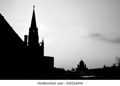 Moscow Kremlin wall and tower - Red Square, Christ the Savior Church silhouette. Black and white photo.