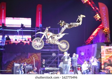 MOSCOW - MAR 02: Jump on a motorcycle with acrobatic elements on the festival extreme sports Breakthrough 2013 in the arena of the Olympic Sports Complex, on March 02, 2013 in Moscow, Russia.