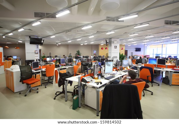 MOSCOW - MAR 5: Employees work in office buildings news agency RIA Novosti with orange furniture on March 5, 2013 in Moscow, Russia.