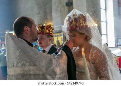 MOSCOW - MARCH 10: priest gives wine to a crowned bride during orthodox wedding ceremony on March 10, 2013 in Moscow
