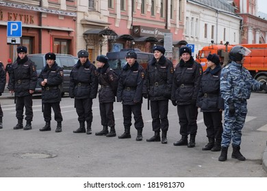 MOSCOW - MARCH 15: Policemans at the protest manifestation against war in Ukraine and Russia's support of separatism in the Crimea, Circular Boulevards in Moscow, Russia on March, 15, 2014.