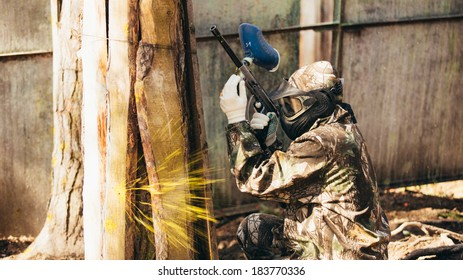 MOSCOW - MARCH 25, 2014: Paintball player in full gear at the shooting range . Photo made at Moscow on March 25 , 2015